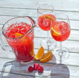 Pitcher of Raspberry Lemonade, two glasses, orange slices. wooden background, up view Stock Images