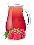 Pitcher of raspberry smoothie. Raspberry smoothie pitcher or jug with fresh raspberries on foreground. Separate clipping paths for whole composite and for shadow Stock Photography
