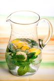 Pitcher refreshing drink. Pitcher delicious refreshing drink of lime and lemon with mint and sugar cane Royalty Free Stock Photo