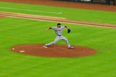 Professional baseball player pitching a ball royalty free stock photo