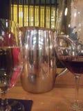 Pitcher silver shiraz dinner wine water glasses restaurant dinning drinking stock photo