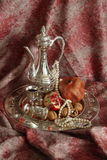 Pitcher. Silver wine pot.Beautiful garnet and pitcher Stock Images