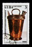 Pitcher, Spanish-Cuban-copper crafts serie, circa 1980. MOSCOW, RUSSIA - NOVEMBER 25, 2017: A stamp printed in Cuba shows Pitcher, Spanish-Cuban-copper crafts Royalty Free Stock Images