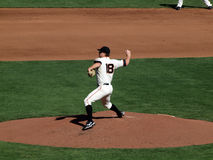 Pitcher steps forward to throw pitch from mound. SAN FRANCISCO, CA - OCTOBER 19:Giants Pitcher Matt Cain steps forward to throw pitch from mound game three of royalty free stock photos