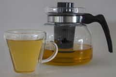 Pitcher of tea with full glass of tea. Pitcher of tea with full cup of tea glass made Royalty Free Stock Photos