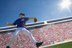 Pitcher throwing baseball Stock Photography