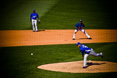 Pitcher throwing baseball Royalty Free Stock Photos