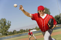 Pitcher Throws A Ball Stock Photo