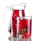 Pitcher and two glasses with cherries Stock Photo
