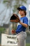 Pitcher waiting for ball. Little league pitcher waiting for the catcher to throw the ball Royalty Free Stock Photos