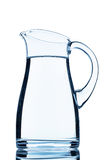 A pitcher of water. Against white background, symbol photo for drinking water, water demand and consumption Royalty Free Stock Images