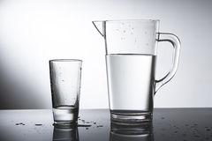 Pitcher of water with glass Royalty Free Stock Images