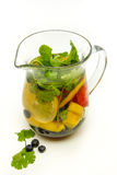 Pitcher of water infused with fruit and mint. A pitcher of water, infused with fruit photographed from above Royalty Free Stock Photo