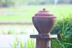 Pitchers in the field. After a very busy farm Im sitting and drinking water in earthen jars a little to be happy.. Traditional concept about Thailand culture Royalty Free Stock Images