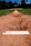 Pitchers mound on baseball field. A baseball base on a little league field in focus royalty free stock photography