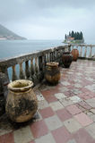 Pitchers on the Terrace. St. George island view from the island of Our Lady of the Rocks, in Kotor Bay, Montenegro Royalty Free Stock Photos