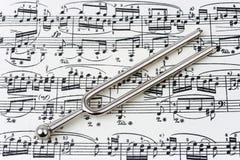 Pitchfork on sheet music