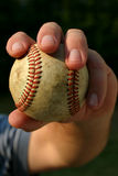 Pitching the ball. Closeup of mans hand ready to throw a baseball Royalty Free Stock Photography
