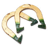 Pitching Horseshoes. Two green and golden throwing horseshoes  on white Royalty Free Stock Images