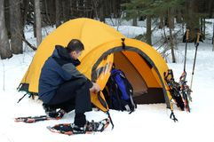 Pitching the Tent. Pitching a tent in the snow. Unusually warm weather makes sleeping outdoors in January downright comfortable on this snowshoe expedition in Stock Images