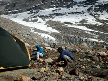 Pitching tent. Traveling and trekking night Stock Image