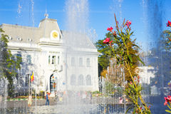 Pitesti Town Hall, Arges, Romania. Flowers and fountain in front of Pitesti town hall, Arges county, Romania royalty free stock photography