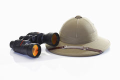 Pith helmet and binoculars Royalty Free Stock Photo