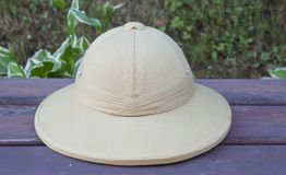 Pith helmet located on the painted bench. Stock Images
