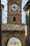 Piticchio (Marches, Italy). Piticchio (Ancona, Marches, Italy) - Clock tower and landscape Royalty Free Stock Image