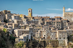 Sorano. Old town in province of Grosseto, Italy. Sorano medieval town on tuff rocky hill. Panorama landscape. Italy, Europe Royalty Free Stock Photo