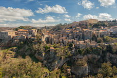 Sorano. Old town in province of Grosseto, Italy. Sorano medieval town on tuff rocky hill. Panorama landscape. Italy, Europe Royalty Free Stock Images