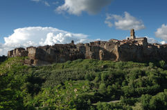 Pitigliano in a sunny day. Pitigliano town in a sunny day with some clouds Stock Photos