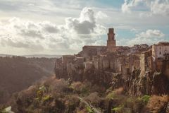 Tuscany Sunset on Pitigliano, Italy. Pitigliano sunset near Tuscany, Italy, cloudscape and landscape featuring the famous tower stock image