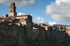 Pitigliano tower. Pitigliano town in a sunny day with some clouds Stock Photos