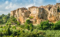 Panoramic sight of Pitigliano in a sunny summer afternoon. Province of Grosseto, Tuscany, Italy. Pitigliano is a town in the province of Grosseto, located about Royalty Free Stock Image