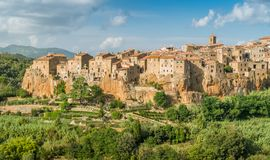 Panoramic sight of Pitigliano in a sunny summer afternoon. Province of Grosseto, Tuscany, Italy. Pitigliano is a town in the province of Grosseto, located about Stock Photo