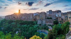 Panoramic sight of Pitigliano at sunset. Province of Grosseto, Tuscany, Italy. Pitigliano is a town in the province of Grosseto, located about 80 kilometres 50 royalty free stock photo