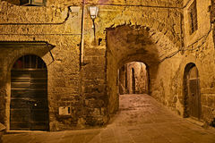 Pitigliano, Tuscany, Italy: alley in the old town Royalty Free Stock Photos
