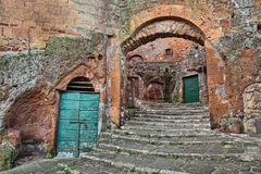 Pitigliano, Tuscany, Italy: old stairway, cellar doors and medie Royalty Free Stock Photos