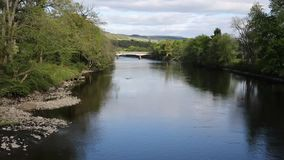 Pitlochry Scotland UK view of River Tummel in Perth and Kinross a popular tourist destination pan. Pitlochry Scotland UK view of River Tummel in Perth and stock footage