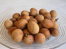 Pitombas on a plate Stock Photography