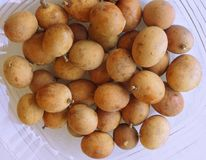 Pitombas on a plate Royalty Free Stock Images