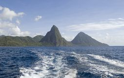 Pitons foggy. Volcano shaped points of the Foggy landmarks Gros Piton 798 meters and Petit Piton 798 meters and mountains along the west coast of st. lucia or st stock image