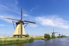 Pitoresque dutch windmill. Alignment of dutch windmills at Kinderdijk listed under the unesco world heritage sites Royalty Free Stock Image