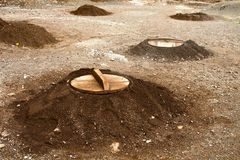 Pits for cooking using heat from underground sources Royalty Free Stock Photography