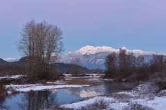 Pitt River and Golden Ears Mountain aftuer sunset Royalty Free Stock Photo