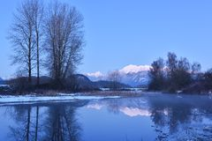 Pitt River and Golden Ears Mountain aftuer sunset Royalty Free Stock Image