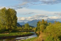 Pitt River and Golden Ears Mountain in spring Royalty Free Stock Photography