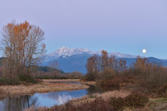 Pitt River and Golden Ears Mountain at sunset and moonrise Royalty Free Stock Photo