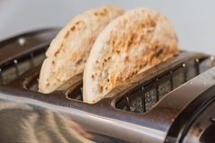 Pitta Bread in a Toaster Stock Photo